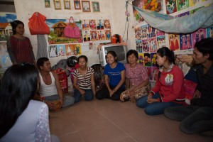 Phong, in blue, talks with other garment workers about their rights.