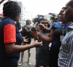 Abuja, Nigeria: Reporters interview Ngozika Reginald during a Bring Back Our Girls rally. Photo courtesy of Womankind Centre for Women Empowerment.