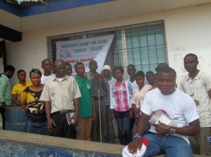 Staff and volunteers from AJWS grantee Grassroots Agency for Social Services (GRASS) in Liberia
