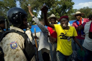 Anti-government protesters in Port-au-Prince last month called for President Michel Martelly's resignation. (HECTOR RETAMAL/AFP/Getty Images)
