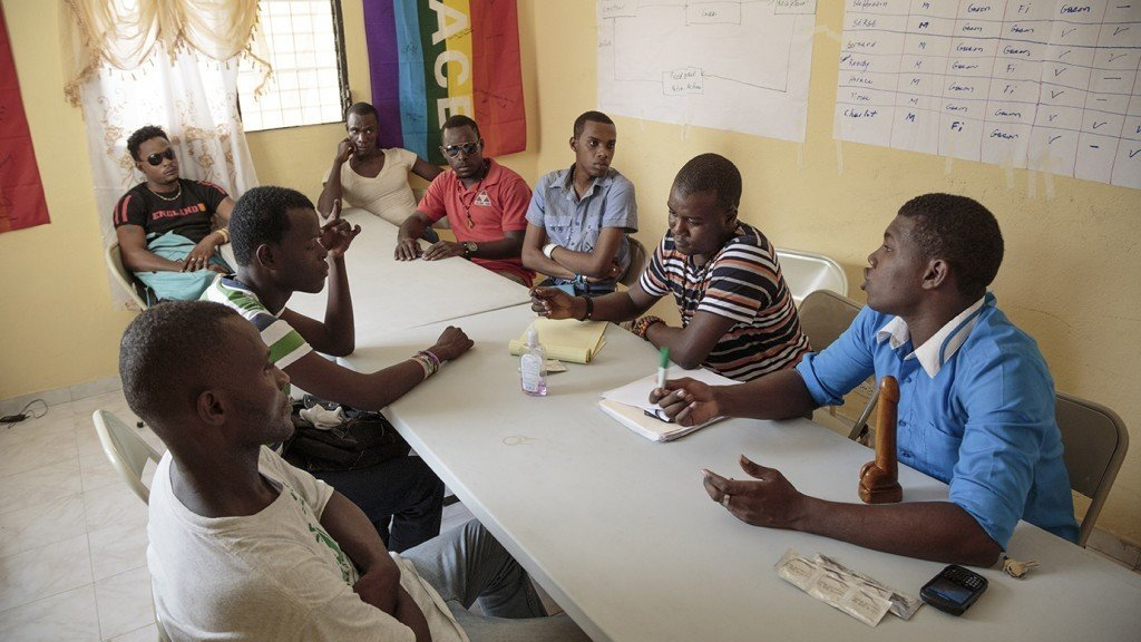A staff meeting at the Kouraj office in Port au Prince, Haiti in July 19, 2014.