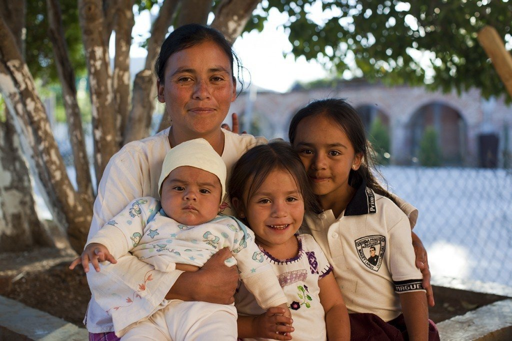 Ester Porres with her baby son Esteban and daughters Hadassa and Rebeca Stefania (left to right) in Maguey Largo, a small village near San Jose del Progreso, where the air and water have been contaminated by dust from the Fortuna Silver mine. In the last two years, more than 8 percent of women in Maguey Largo have experienced late-term miscarriages. The community believes pollution from the mine is to blame. Photo by Evan Abramson