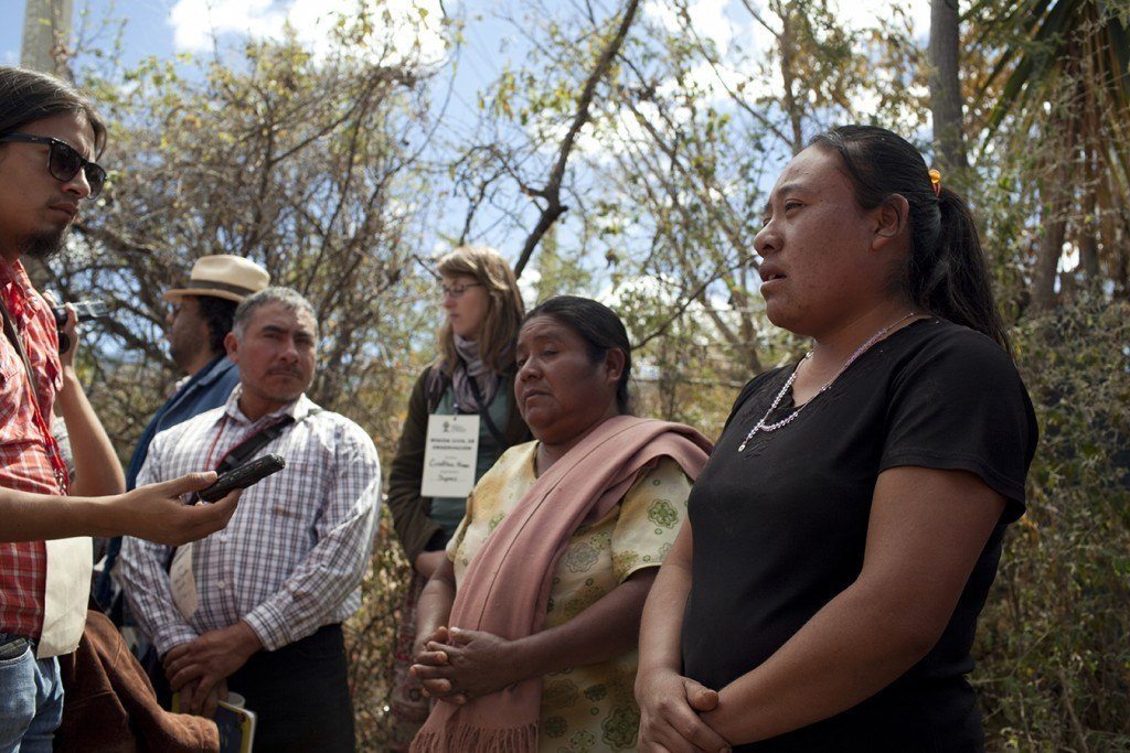 "Grisela Mendez Gonzalez attests that her father, Bernardo Mendez, was murdered by supporters of the mine in January 2012, while protesting the construction of a water pipe that townspeople believed was diverting the town's water supply to the mine. (Bernardo Vasquez Sanchez was killed just a few months later.) Bernardo Mendez's widow, Dolores Apolinia Gonzalez Ramirez, stands next to her daughter. ""We don't want violence. All we want is for the mine to go,"" she said. Photo by Evan Abramson"
