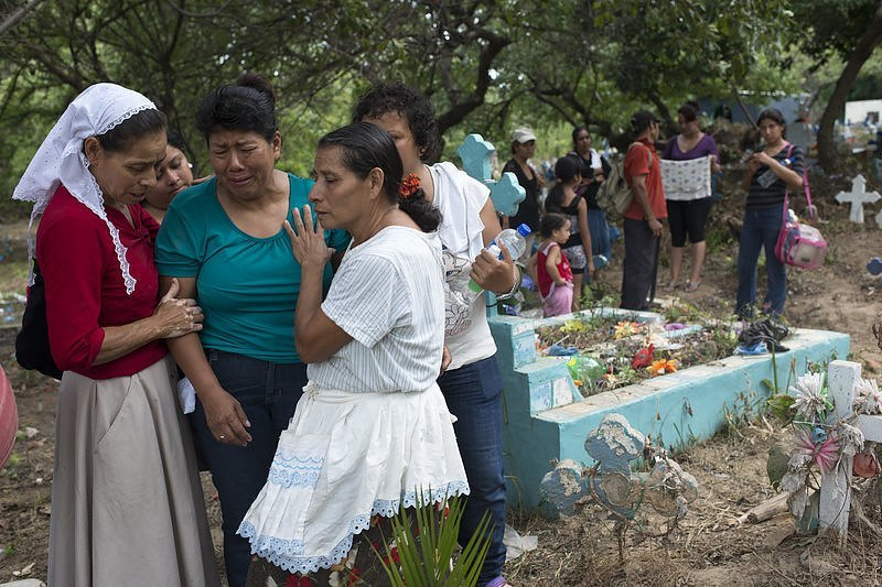 The mother of an assassinated bus driver buries her son at a cemetery on the outskirts of San Salvador. By Encarni Pindado for NPR