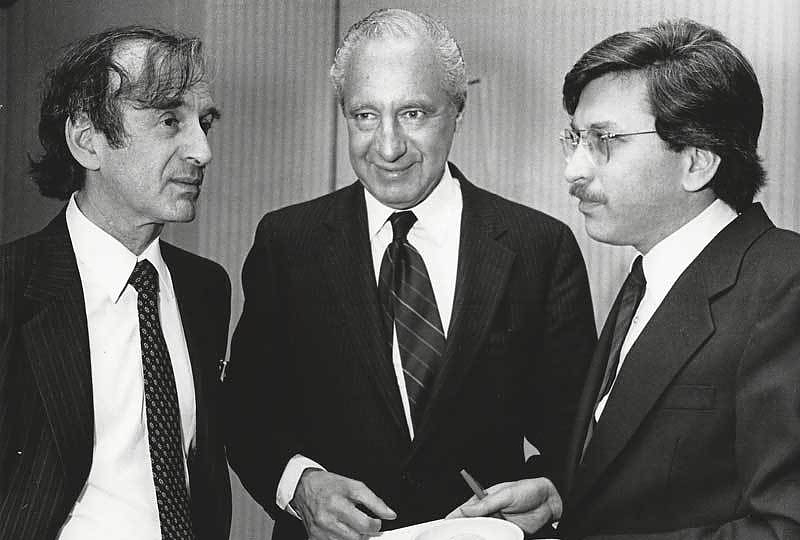 Elie Wiesel with AJWS founders Larry Phillips (center) and Lawrence Simon (right) in 1985
