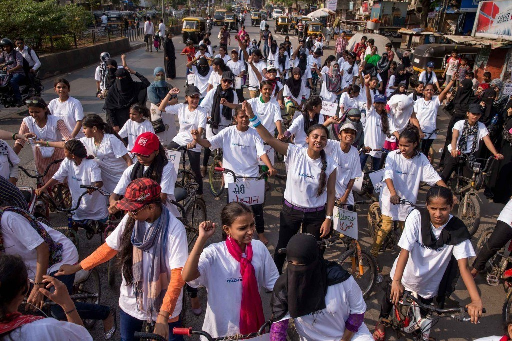 Nearly 100 women and girls from Awaaz rode through the busy streets of a conservative community in Mumbai to rally for gender equality. Photo by Jonathan Torgovnik.