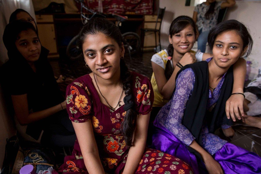 Adolescent girls hang out at Awaaz-a-Niswaan in Mumbai. Formed 30 years ago to challenge laws in Muslim communities that restrict women's rights, Awaaz now organizes gatherings for women and girls to learn how to advocate for themselves. They offer computer and English classes that provide young women with strict parents an excuse to get out of the house and seek support from friends. Photo by Jonathan Torgovnik.