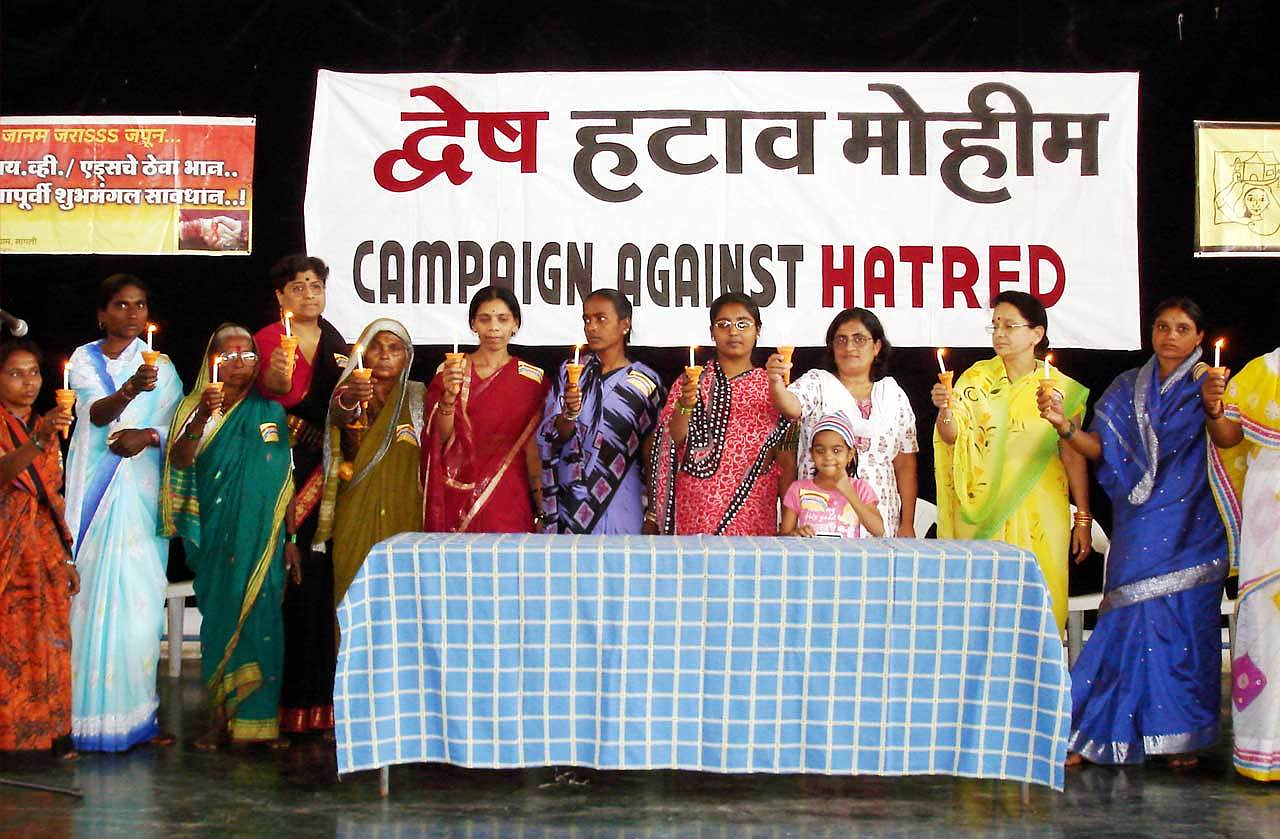 Meena Seshu (second from left) at a vigil with SANGRAM. Photograph courtesy of SANGRAM.