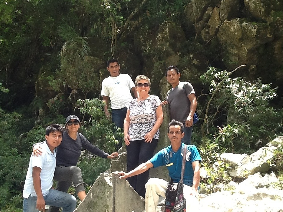 Megan Thomas (AJWS consultant in Guatemala) with ACODET youth leaders standing on the markers (used for dam construction)