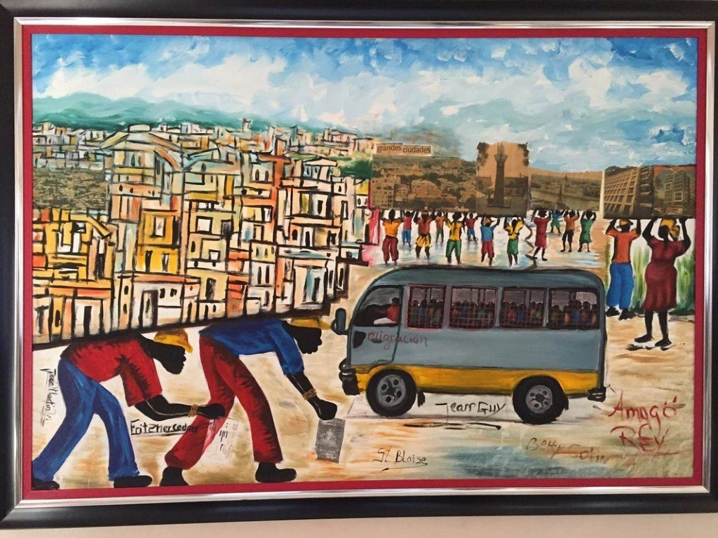 "This painting, which hangs in Centro Bono—the Jesuit social center that holds many AJWS grantees—illustrates the citizenship crisis in the Dominican Republic. One of the two workers depicted carries a Haitian passport. To his right is an immigration bus rounding up Haitians to deport. ""The paradox of the painting is its suggestion that the Dominican Republic was built on the backs of Haitians and those of Haitian descent—and that the country is literally lifted up and supported by/because of them,"" says Rabbi Jeffrey Brown, who visited the social center with a group of other rabbis during a Global Justice Fellowship trip with AJWS."