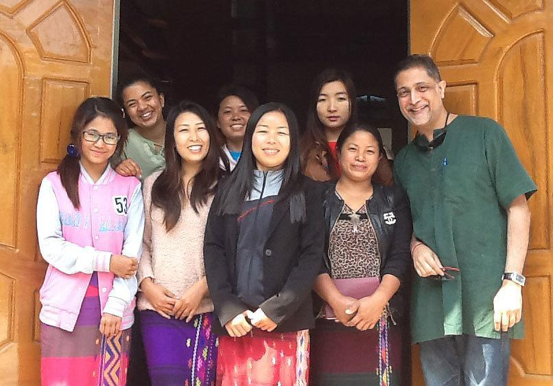 AJWS Senior Policy Advisor, Government Affairs Ronnate Asirwatham (top left) and AJWS Director of Natural Resource Rights Nikhil Aziz (right) with members of AJWS grantee the Kachin Women's Association of Thailand