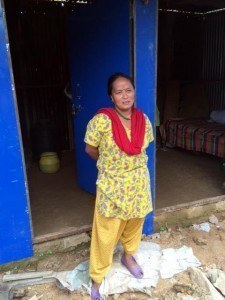 Indra Maya, a widow who survived the earthquake, lost the home that her son had built for her just three months before the disaster. AJWS grantee Himalayan Climate Initiative helped them and 42 other families rebuild.