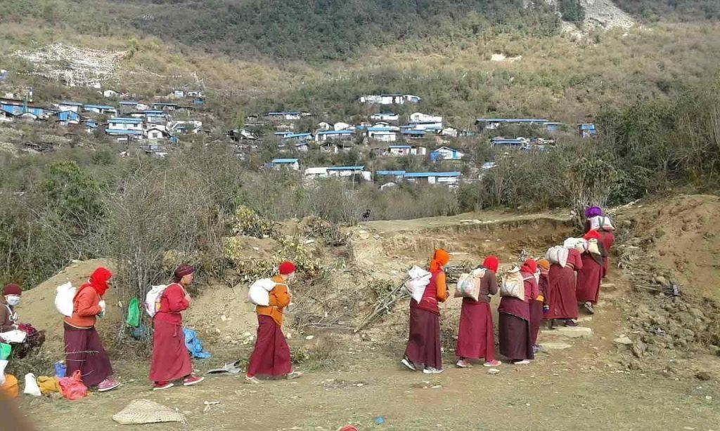 Tibetan refugee Buddhist nuns who lost their homes in the 2015 Nepal earthquake journey back to their remote mountain community to begin the rebuilding process with help from AJWS grantees.