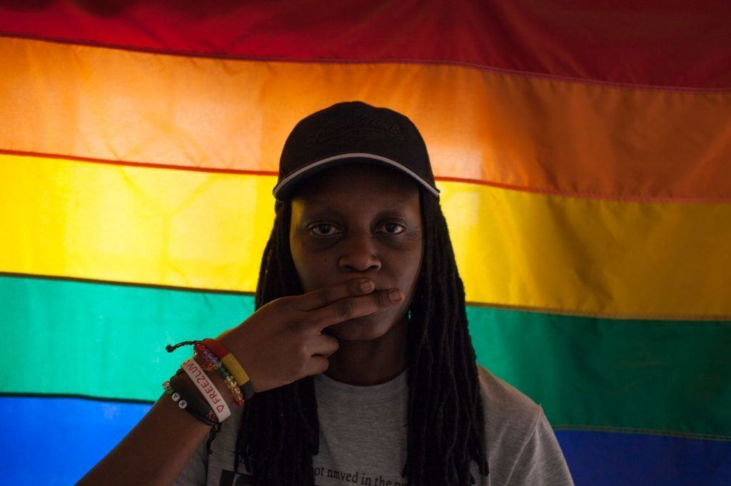 "February 26, 2013--Evan Abramson/AJWS--Kasha Jacqueline Nabagesera, Executive Director of FARUG, is one of the few members of the organization that is completely out as a lesbian in Uganda. Her life is particularly at threat recently, following the publication of her photograph in an article titled ""Busted: How Gays Operate in Uganda"" in the notorious tabloid 'Red Pepper.' Homosexuality is already illegal in the African nation and LGBTQ people are routinely attacked there. The nation's parliament is debating a harsh antigay law that could include a death sentence for some acts."
