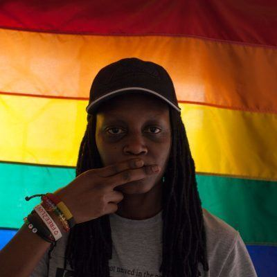 """February 26, 2013--Evan Abramson/AJWS--Kasha Jacqueline Nabagesera, Executive Director of FARUG, is one of the few members of the organization that is completely out as a lesbian in Uganda. Her life is particularly at threat recently, following the publication of her photograph in an article titled """"Busted: How Gays Operate in Uganda"""" in the notorious tabloid 'Red Pepper.' Homosexuality is already illegal in the African nation and LGBTQ people are routinely attacked there. The nation's parliament is debating a harsh antigay law that could include a death sentence for some acts."""