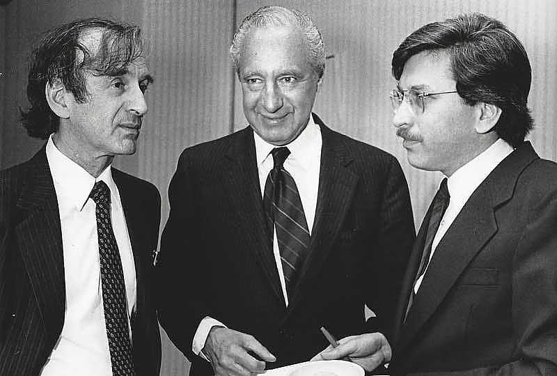AJWS founders Larry Phillips (center) and Laurence Simon (right) celebrate AJWS's founding in 1985 with author Elie Wiesel, a founding board member.