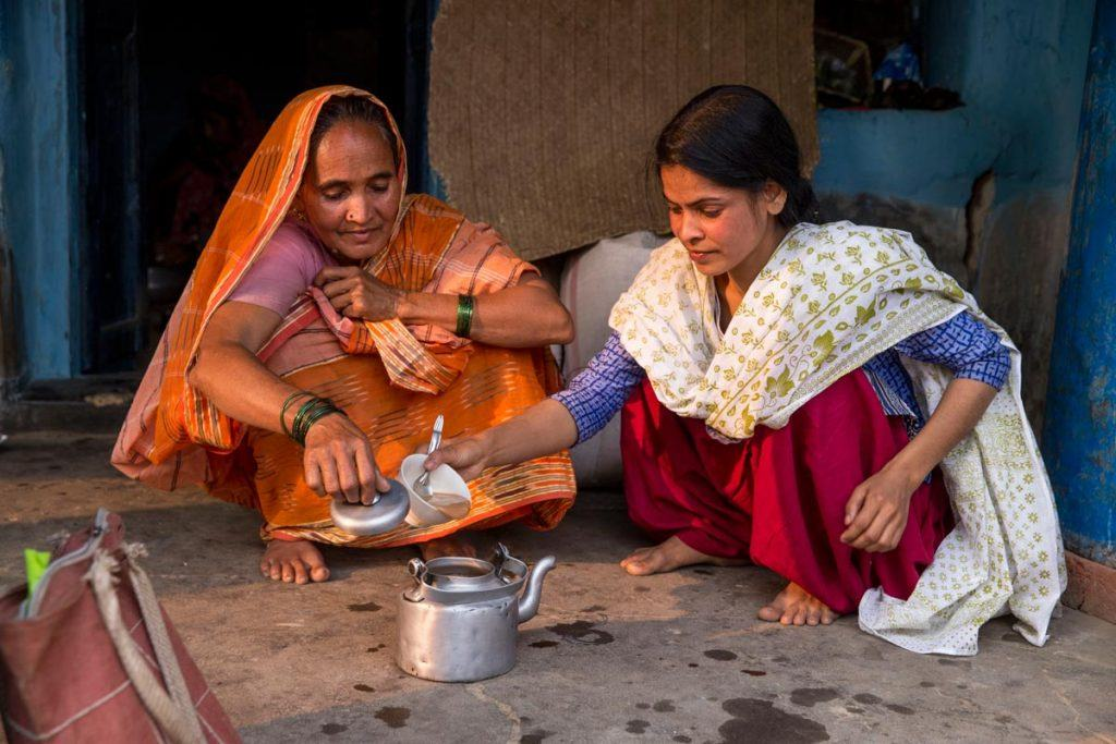 Sonali Khatun, right, prepares chai with her mother in rural West Bengal. Forced to marry at age 14, Sonali convinced her parents to let her divorce. With support from AJWS grantee MBBCDS, she has weathered the intense stigma against divorce in her community and started counseling other girls on their rights. Photo by Jonathan Torgovnik