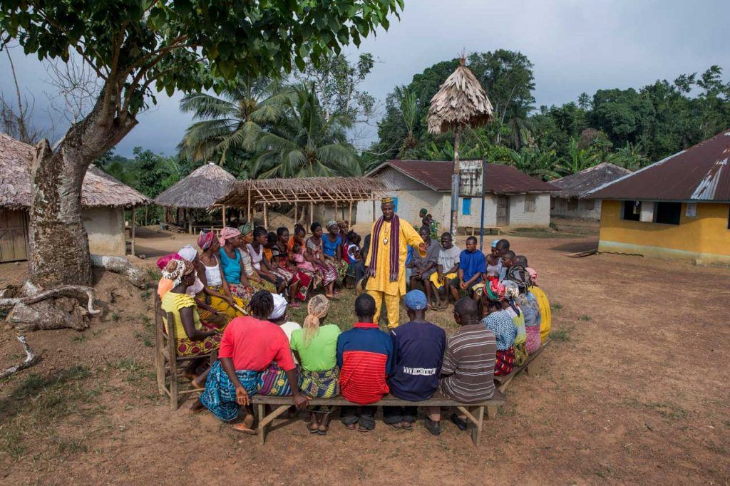 A chief elder (center, in yellow) leading a community meeting in Grand Bassa County, Liberia, in January 2016. The new bill aims to give local communities greater say over how their land is used. Photo by Jonathan Torgovnik