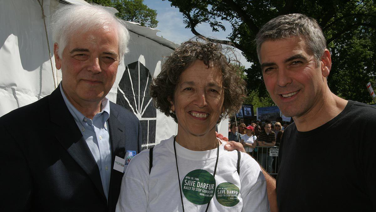 Ruth Messinger with journalist and anchorman Nick Clooney and his son, actor, writer and producer George Clooney, after a 2006 rally for Darfur on Washington's National Mall.