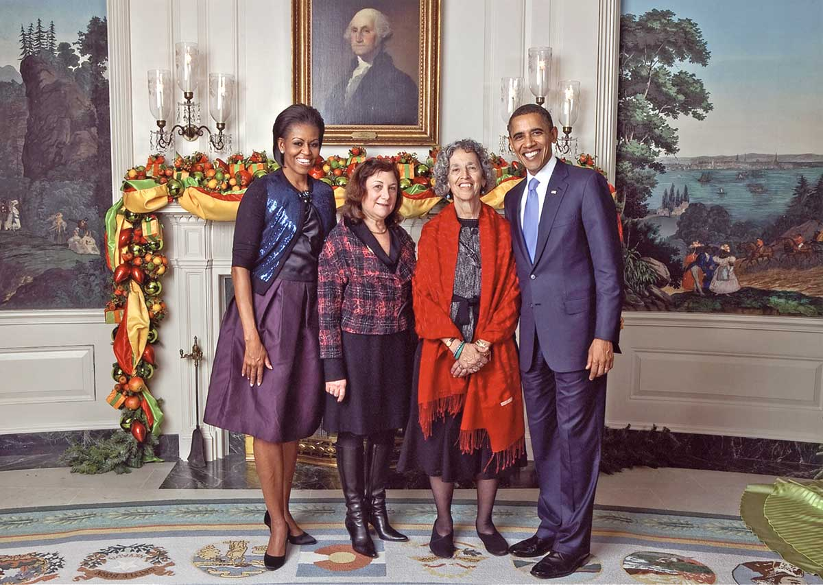 Ruth Messinger and former AJWS Vice President for External Affairs Phyllis Goldman with President Barack Obama and First Lady Michelle Obama at the 2008 White House Christmas party.