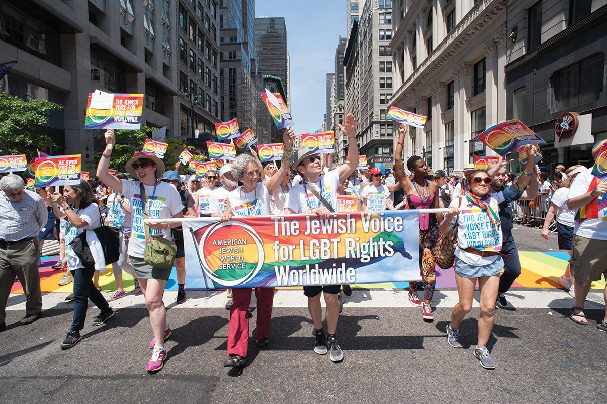 In the 2016 NYC Pride Parade, Ruth Messinger marches alongside AJWS's then-Executive Vice President (now President) Robert Bank, board members, staff and supporters. Photograph by Jeff Zorabedian