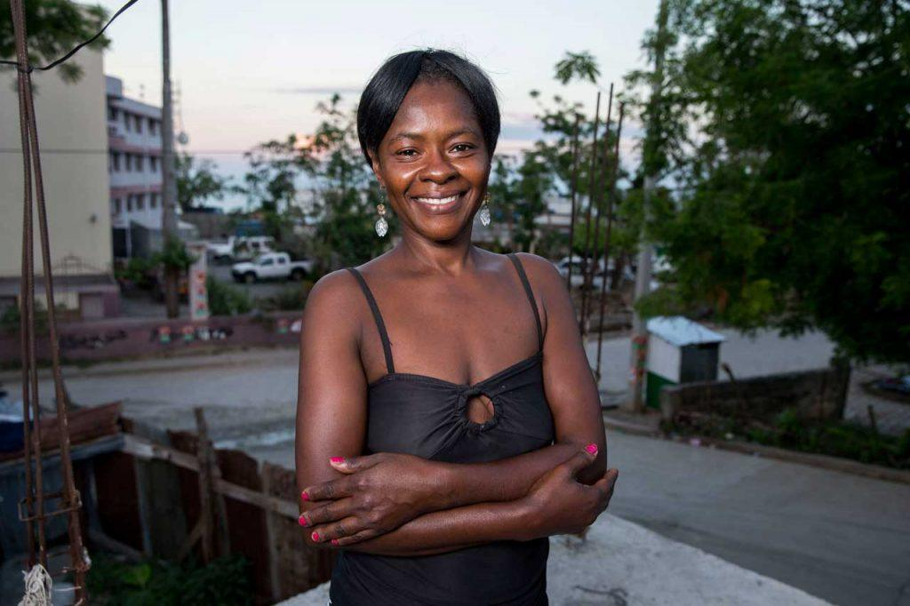 Heroes like Françoise Inocent, who is happy and smiling, are helping communities in Haiti rebuild and recover after Hurricane Matthew. Photograph by Jonathan Torgovnik