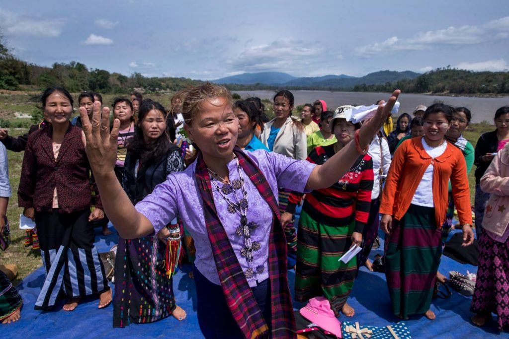 Lu Ra leads a large group women in song and dance, uniting the women from different villages who sing about their river and their leadership.