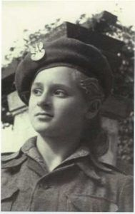 A black-and-white photo of Edna Brill as a young girl. She is looking to the left of the camera and wearing a hat.
