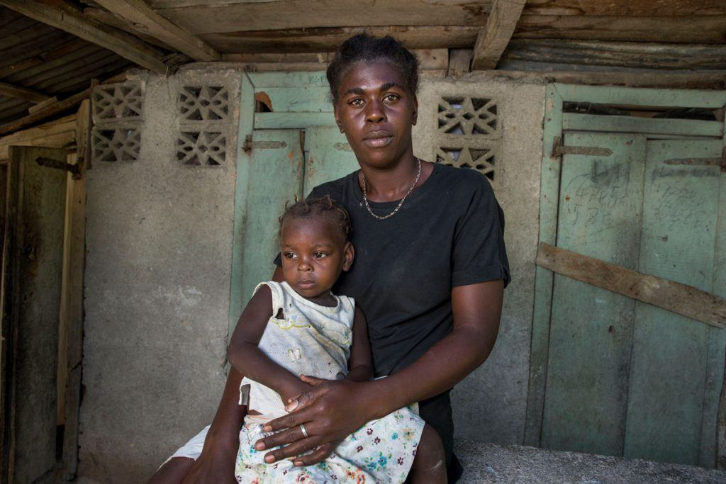 Marjorie Joseph and her 2-year old daughter avoided water-borne diseases thanks to GARR's efforts to raise awareness in communities along the Haiti-Dominican Republic border. Photo by Jonathan Torgovnik