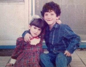 Malka Friedman-Rosner and her brother Akiva in front of their home. Photo courtesy of Malka Friedman-Rosner