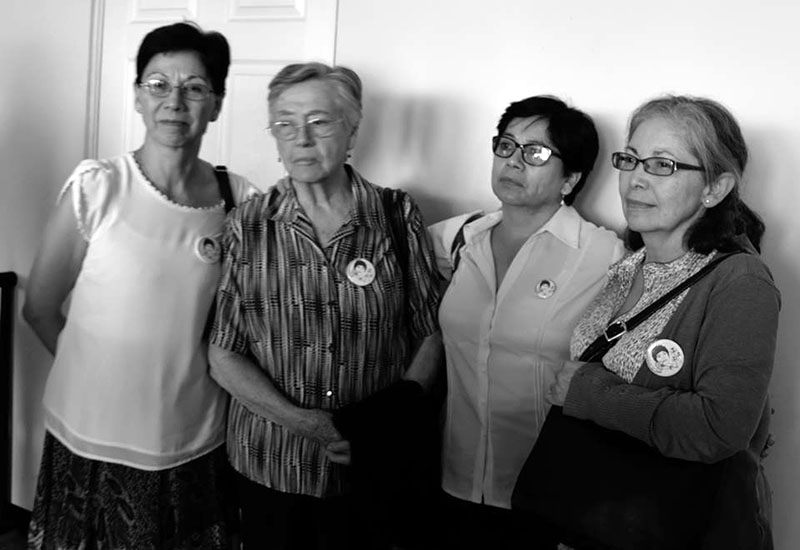 Surviving members of the Molina Theissen family standing together solemnly the day before the verdict. Photo credit: Prensa Comunitaria.