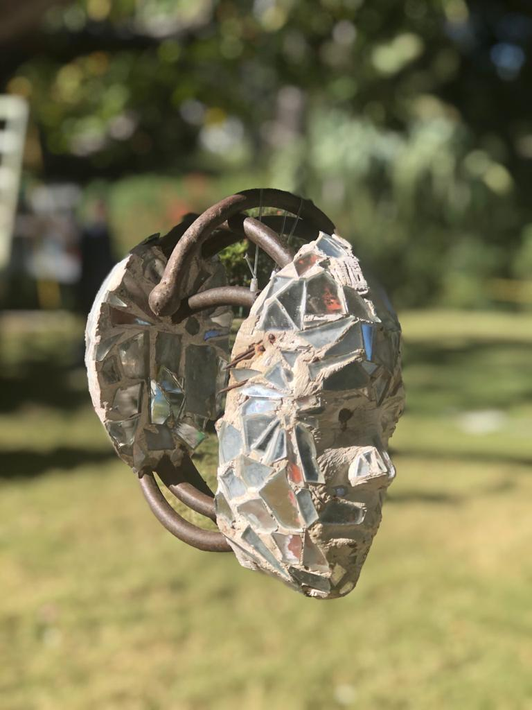 An art installation at Martissant Park memorializes earthquake victims with suspended crystal head sculptures. The gentle breeze in the park made the installation all the more powerful. Photos by Amber Lynn Munger.